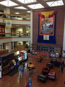 Campus library: A giant thangkha of the Four Friends hangs over a 100-foot altar in the lobby.  At the espresso stand on the left, the barista told me the architecture is even starting to seep into other places around El Paso